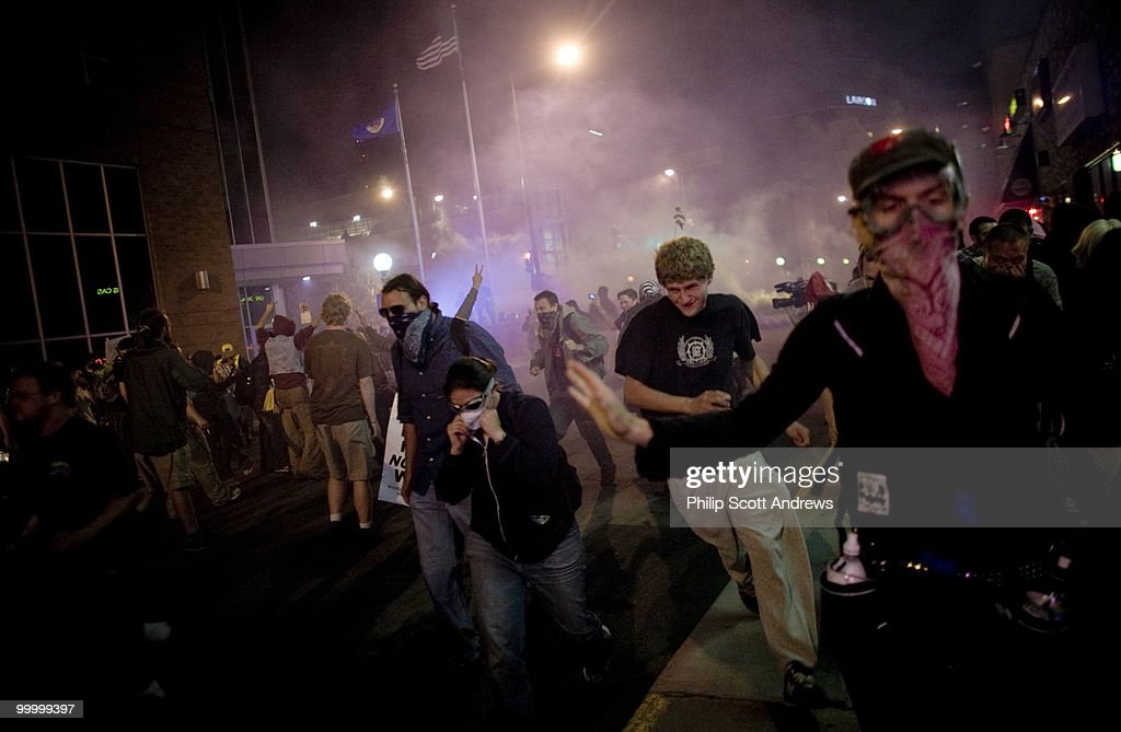 Protestors scramble after riot police detonated percussion grenades and fired tear gas in order to disperse an otherwise peaceful march. The activists, along with members of the media, were sprayed with tear gas even after they had moved away from the scene.