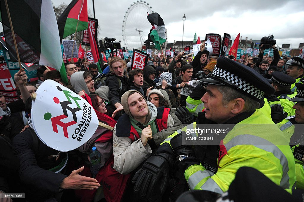 Protestors scuffle with police officers during a student rally in central London on November 21, 2012 against sharp rises in university tuition fees, funding cuts and high youth unemployment.