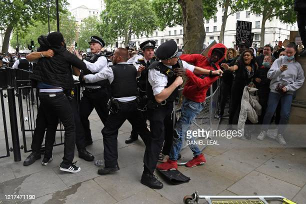 Protestors scuffle with Police officers near the entrance to Downing Street, during an anti-racism demonstration in London, on June 3 after George...