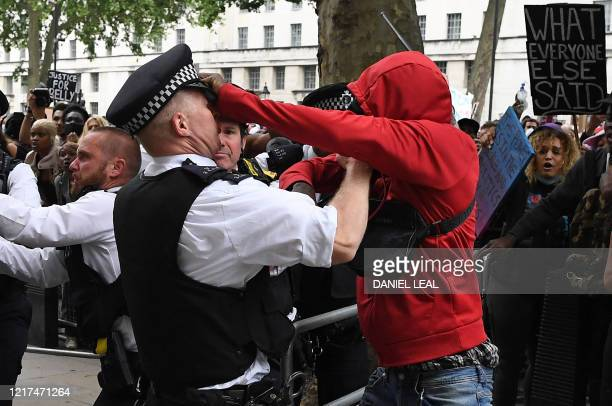 Protestors scuffle with Police officers near the entrance to Downing Street during an antiracism demonstration in London on June 3 after George Floyd...