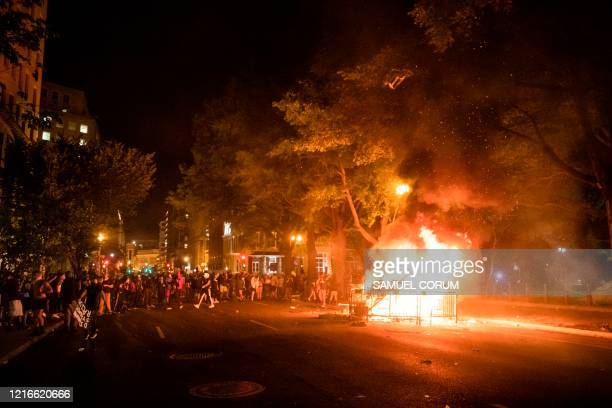 Protestors set a fire in the street a block from the White House while protesting the death of George Floyd at the hands of Minneapolis Police in...