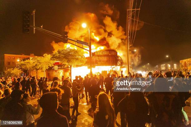 Protestors set a shop on fire on Thursday, May 28 during the third day of protests over the death of George Floyd in Minneapolis. Floyd died in...