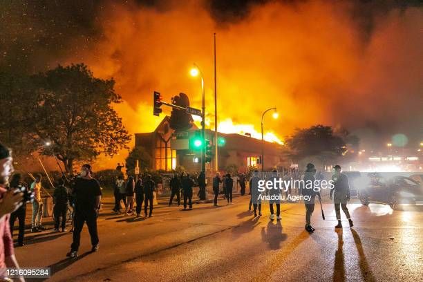 Protestors set a shop on fire on Thursday May 28 during the third day of protests over the death of George Floyd in Minneapolis Floyd died in police...