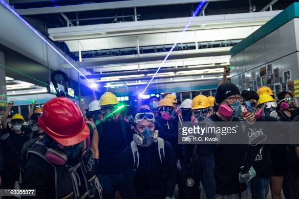 Protestors shine laser pointers during a protest at the Yuen Long MTR station on August 21, 2019 in Hong Kong, China. Pro-democracy protesters have...