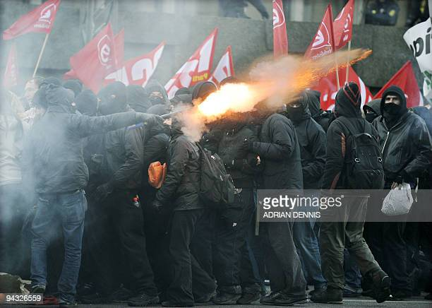 Protestors shoot a firework at police officers guarding the Foreign Ministry as the climate march turns viokent in the centre of Copenhagen December...