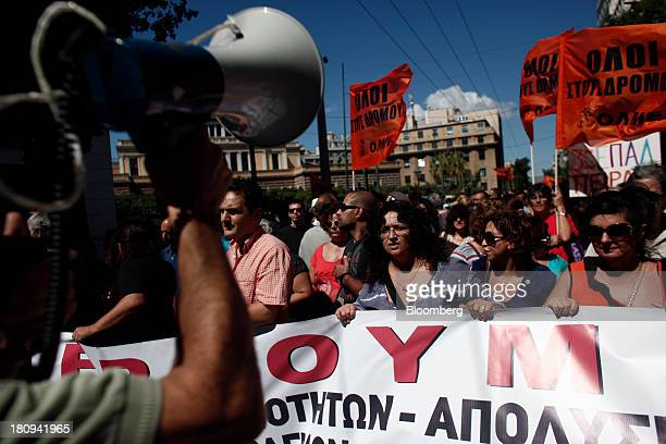 Protestors shout antigovernment slogans during a demonstration to mark the start of a 48hour strike by Greece's biggest publicsector union ADEDY in...