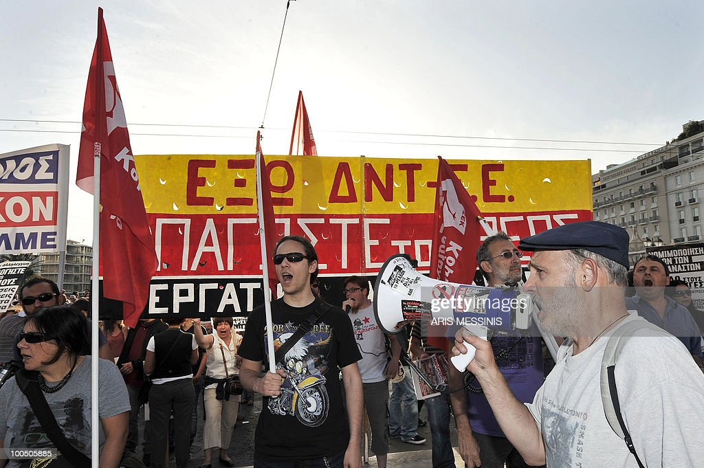 Protestors shout anti-government slogans in front of the Greek Parliament in the center of Athens on May 6, 2010. More than 10,000 people demonstrated peacefully in Greek capital as lawmakers voted on a drastic austerity package, a day after protests against cutbacks degenerated into deadly riots, police said.