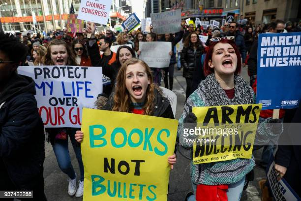 Protestors shout as they march down Sixth Avenue during the March For Our Lives March 24 2018 in New York City Thousands of demonstrators including...