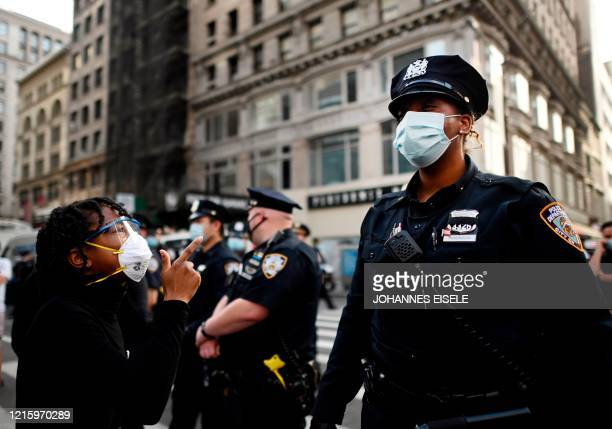 TOPSHOT Protestors shout in front of NYPD officers during a Black Lives Matter demonstration on May 28 2020 in New York City in outrage over the...