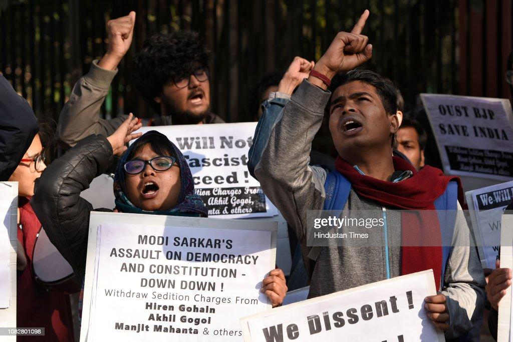 Protestors shout slogans against Prime Minister Narendra
