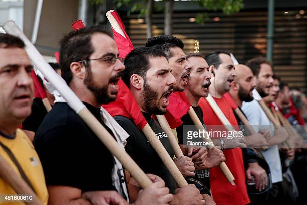 Protestors shout slogans as they march during an antiausterity rally organized by the Communist Party in Athens Greece on Wednesday July 22 2015...