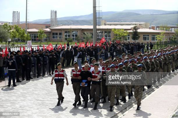 Protestors shout slogans as Turkish Gendarmerie escort defendants Akin Ozturk and others involved in last Julys attempted coup in Turkey as they...