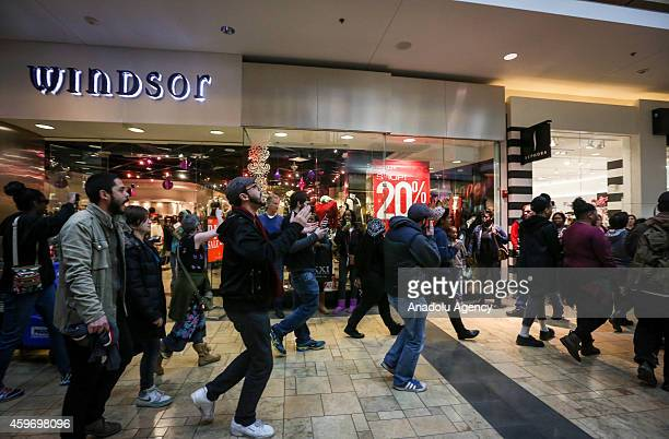 Protestors shout slogans at West Country Center Mall near Ferguson on November 282014 during a rally against the Grand Jury's decision not to indict...