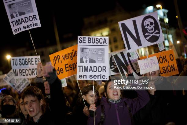 Protestors shout slogans during a demonstration against alleged corruption scandals implicating the PP on the streets of Madrid on February 3 2013 in...