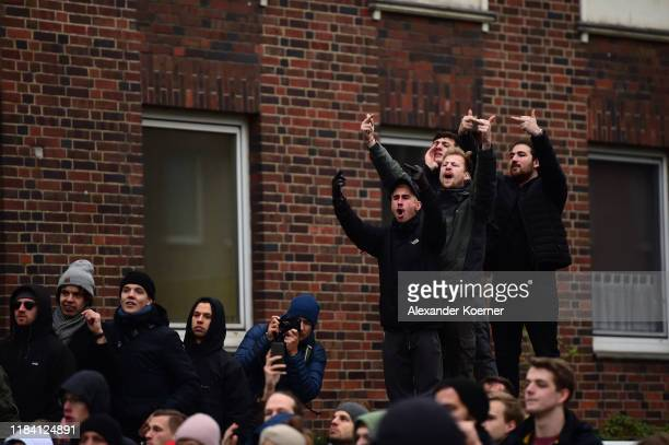 Protestors shout slogans towards Neo-Nazis and right-wing supporters during a march to voice their anger at the reporting by journalists Julian...