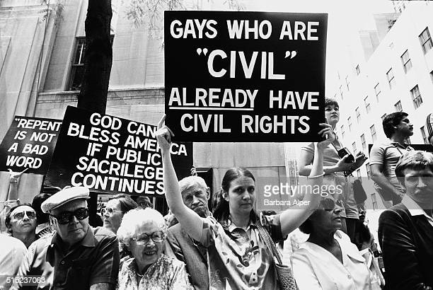 Protestors show their distaste at a Gay Pride parade in New York City USA June 1983