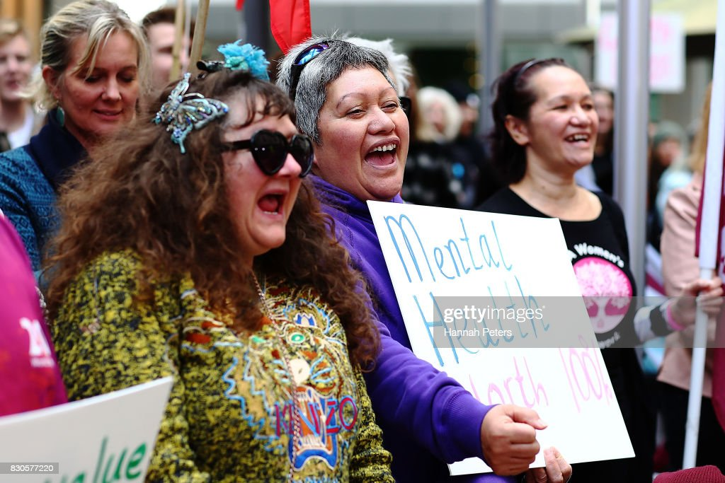 Protestors show their support during a rally for pay equity in New Zealand on August 12, 2017 in Auckland, New Zealand. Opposition MPs and members of the public are protesting against the government's Pay Equity Bill ahead of its anticipated first reading in parliament on Tuesday.