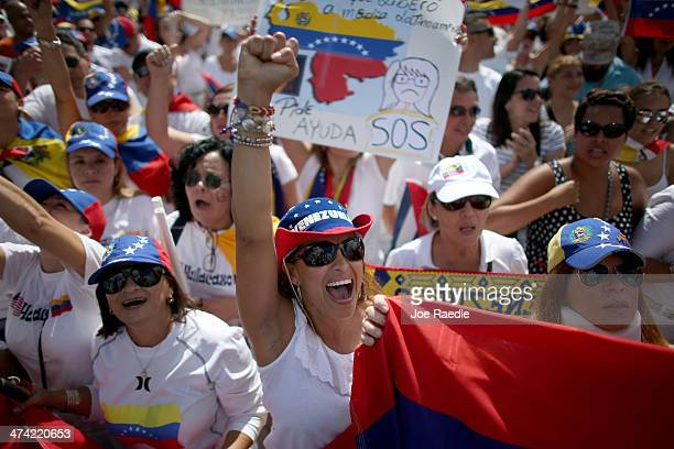 Protestors show their support with the antigovernment protests in Venezuela on February 22 2014 in Doral Florida In Venezuela protests over the past...