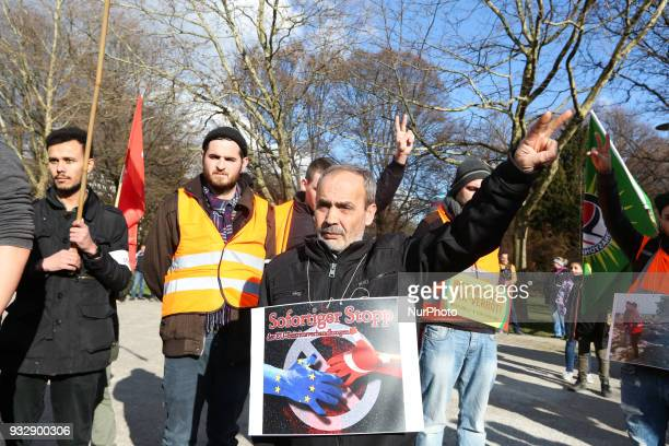 Protestors showing the peace sign during a minute of silence undreds of people demonstrated in Munich Germany on 16 March 2018 to remember the...