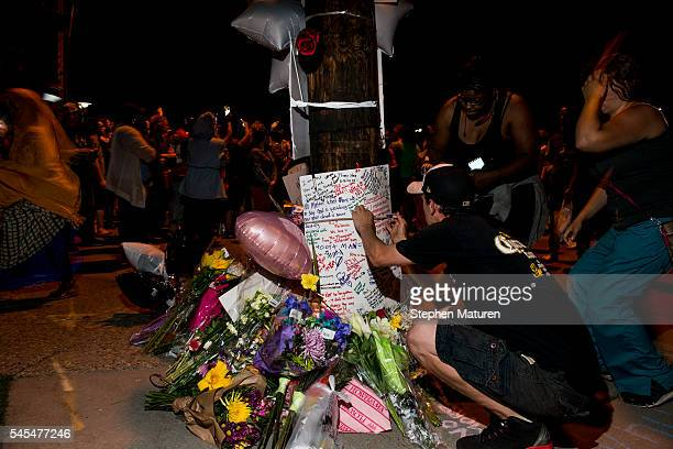 Protestors sign a memorial at the intersection where Philando Castile was shot on July 7 2016 in Falcon Heights Minnesota Castile was shot and killed...