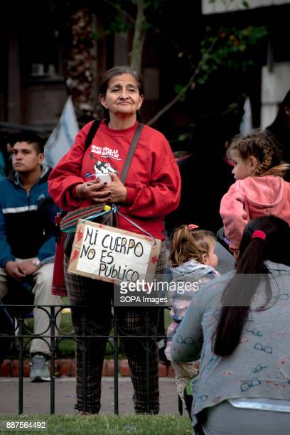 A protestor's sign reads 'My body is not public [property]' Marching from the nation's iconic Congreso buildings to Plaza De Mayo these women are...