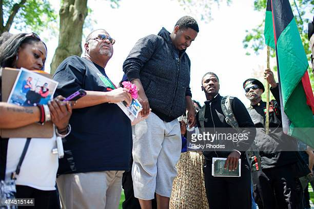 Protestors sing in front of a mock casket for Tamir Rice as people take to the streets in reaction to Cleveland police officer Michael Brelo being...