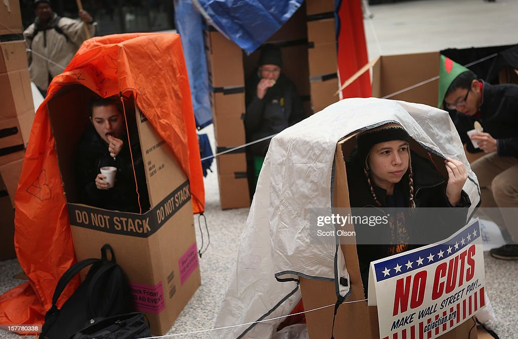Protestors sit in shanties constructed of cardboard in the Federal Building Plaza on December 6, 2012 in Chicago, Illinois. The shantytown, which they dubbed 'Durbinville' after U.S. Senator Dick Durbin (D-IL), was built to persuade Durbin to push for an increase of taxes on the wealthy and oppose cuts in Social Security, Medicare, and Medicaid