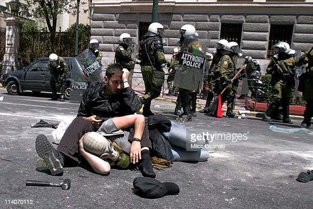 Protestors sit on the ground after clashes erupted during a general strike that halted services and disrupted flights May 11 2011 in Athens Greece...