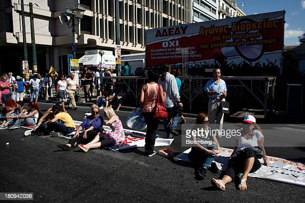 Protestors sit on their banners ahead of a 48hour strike by Greece's biggest publicsector union ADEDY in central Athens Greece on Wednesday Sept 18...