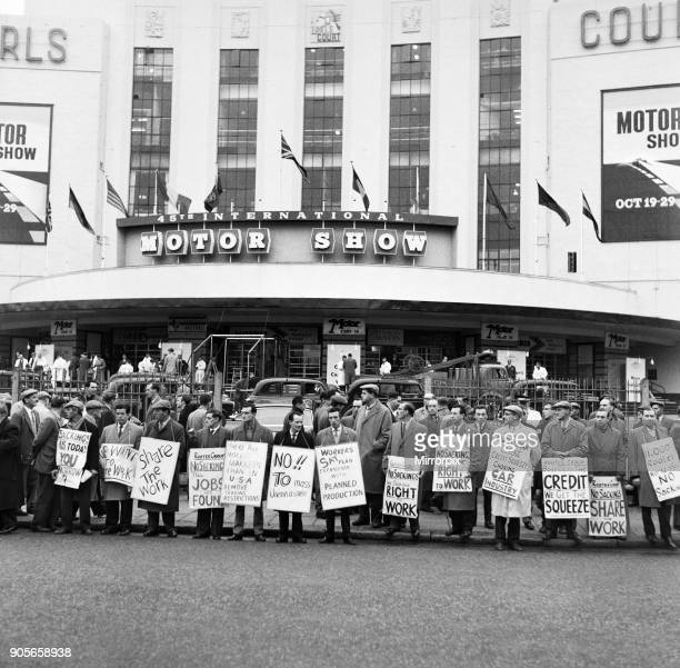 Protestors stage a demonstration in Warwick Road London outside the Earls Court Motor show in protest against redundancy sackings at the Cricklewood...
