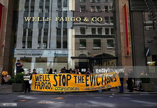 Protestors stage a demonstration outside of the Wells Fargo headquarters on April 23 2013 in San Francisco California A few dozen protestors with the...