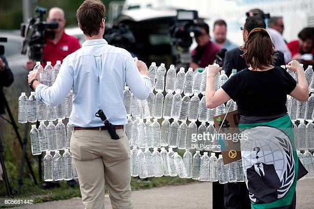 Protestors stand before the news media at a press conference to protest Republican Presidential Nominee Donald Trump's visit to Flint today at the...
