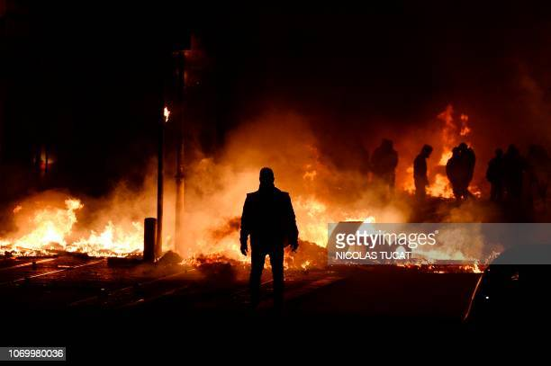 Protestors stand near a fire on December 8, 2018 in Bordeaux, southwestern France, on the sideline of a demonstration against rising costs of living....