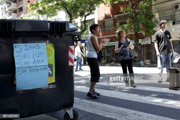 Protestors stand next to a dumpster in the street in the Villa Crespo neighborhood of Buenos Aires Argentina on Wednesday Jan 8 2014 Empresa...