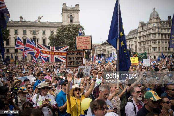 Protestors stand on Parliament Square as they take part in the People's Vote demonstration against Brexit on June 23 2018 in London England On the...