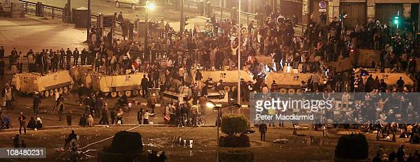 Protestors stand on top of army tanks in Tahrir Square on January 29, 2011 in Cairo, Egypt.Thousands of police are on the streets of the capital....