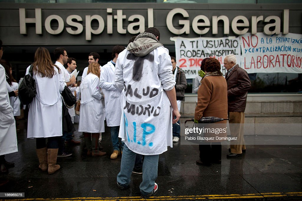 Protestors stand outside La Paz Hospital on November 26, 2012 in Madrid, Spain. Trade unions for the first time have called for a 48 hour health worker's general strike in the Madrid Region after Regional Government announced severe cuts and privatization of Medical Centers.