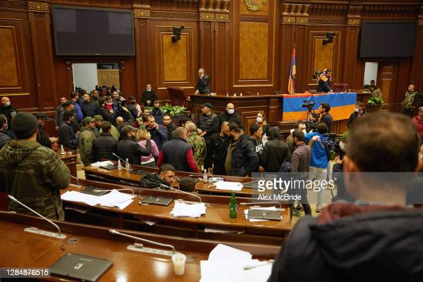 Protestors storm the Armenian parliament building after the announcement of a peace deal in the war between Armenia and Azerbaijan on November 10,...