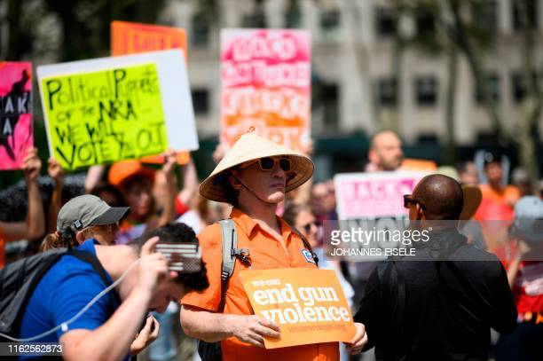 Protestors take part in a rally of Moms against gun violence and calling for Federal Background Checks on August 18, 2019 in New York City.