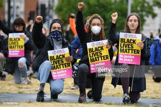 Protestors take part in a Take The Knee demonstration in solidarity with Black Lives Matter in Windrush Square Brixton south west London on June 10...