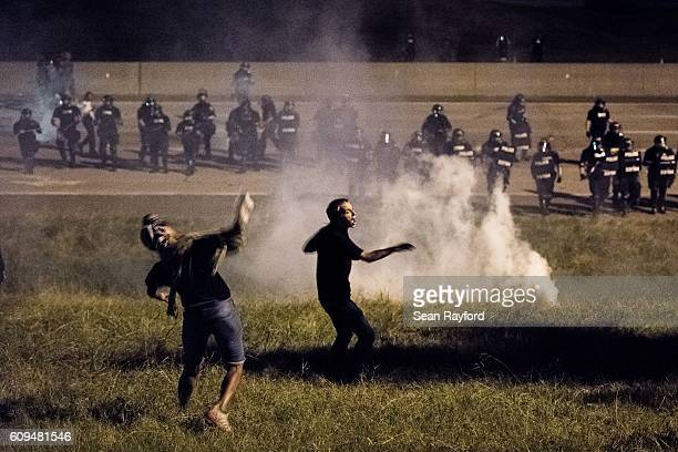 Protestors throw objects at police officers on the I85 d during protests in the early hours of September 21 2016 in Charlotte North Carolina The...