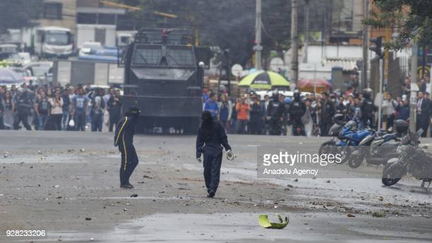 Protestors throw rocks at riot police attempt after clashes broke out between students and riot police during a protest due to dissatisfaction of...