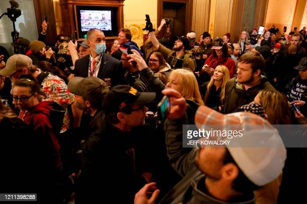 Protestors try to enter the Michigan House of Representative chamber and are being kept out by the Michigan State Police after the American Patriot...