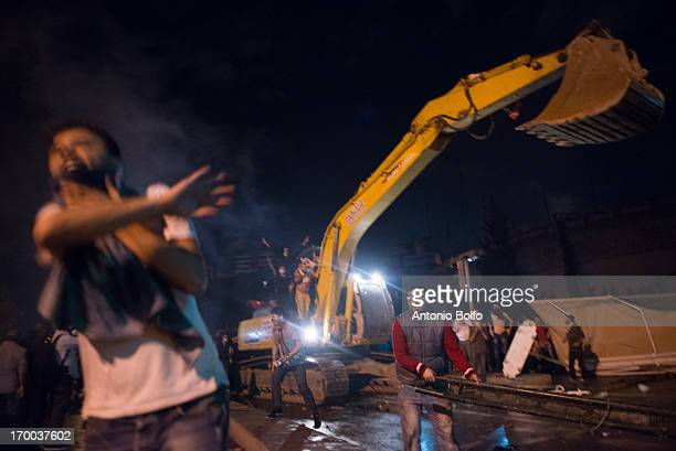 Protestors use heavy machines to fight Istanbul police to reach the Prime Minister's building June 2 2013 in Istanbul Turkey People started...