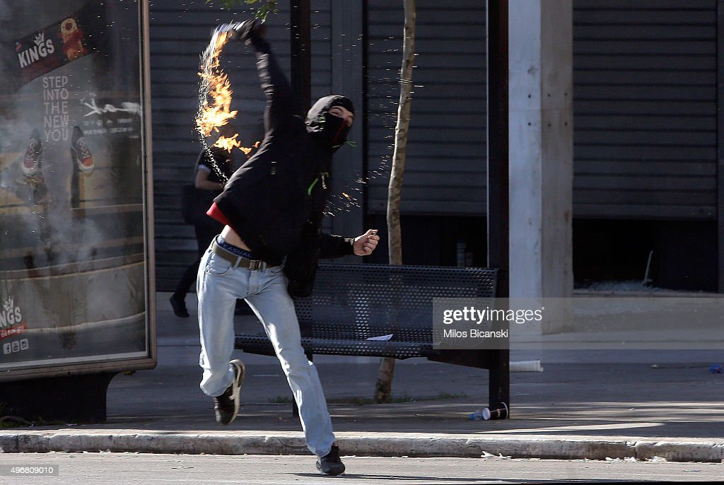 Protestors use molotov cocktails during brief clashes between police and protesters during a 24-hour nationwide general strike on November 12, 2015 in Athens, Greece. This is the first general strike since the country's Syriza-Led Government came to power.