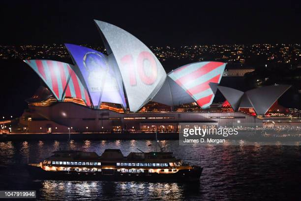 Protestors use torches and other light sources to disrupt a promotional light show on the Opera House for the Everest Cup horse race on October 9...