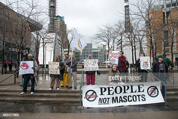 Protestors voice their opinion about Cleveland Indians mascot Chief Wahoo outside Progressive Field prior to the game between the Cleveland Indians...