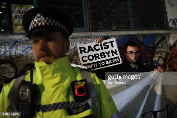 Protestors wait for the arrival of Labour leader Jeremy Corbyn in Hoxton on December 11 2019 in London United Kingdom Corbyn is speaking to Labour...