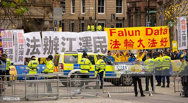 Protestors wait for the President of the People's Republic of China Xi Jinping as he visits Manchester Town Hall on October 23 2015 in Manchester...