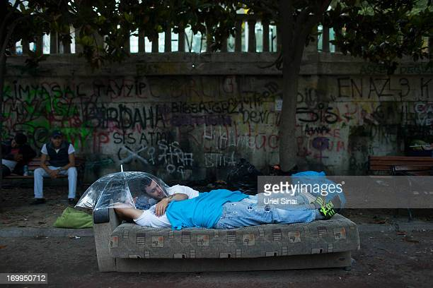 Protestors wake early morning at the Gezi park in Taksim Square on June 5 2013 in Istanbul Turkey The protests began initially over the fate of...